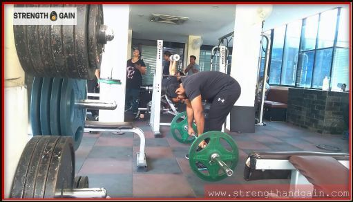 Holding 40kg barbell with a round back showing poor form