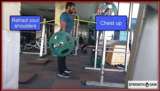 Starting position for barbell bent over rows holding 40 kg weight