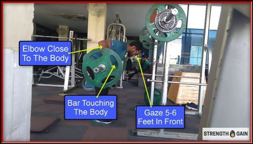 demonstrating bent over rows form for strength and gain