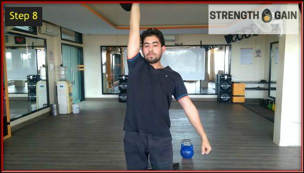 Standing part of turkish get up using a 12kg kettlebell
